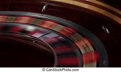 One part of roulette wheel fast running, white ball falls -...