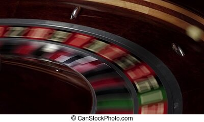 Roulette wheel fast running, white ball falls - Roulette...