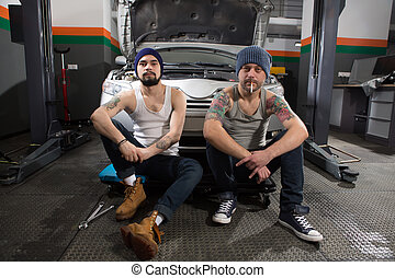 Workers at service station - Picture of mechanic workers...