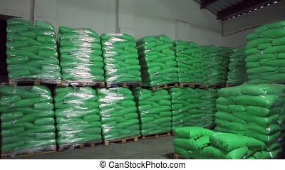 Green Bags with Products in Stock Warehouse.