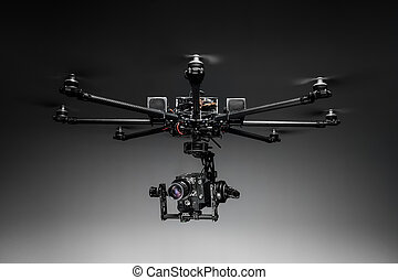 Studio shot of drone with digital camera - Multicopter...