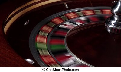One part of fast running wheel roulette, white ball falls on...