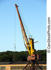 loading crane on background of forest