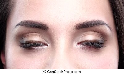 Brown women's eyes blink. Close up - Brown women's eyes...