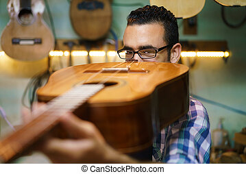 Lute Maker Checking Bridge And Arm Of Classic Guitar - Lute...