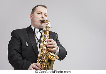 Music Concept and Ideas Portrait of Caucasian Player in Suit...