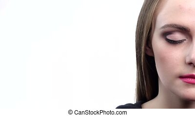 Beautiful half-face with blue eyes, blink , white background, close up
