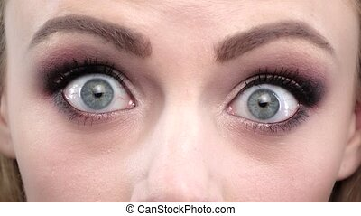 Girls blue eyes in wonder Close up - Girls blue eyes in...
