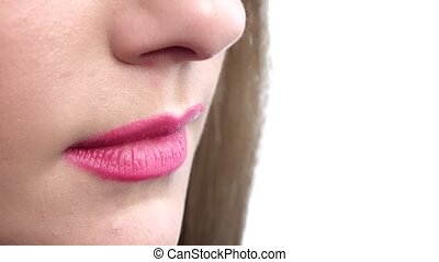 Woman biting her beautiful lips. Closeup