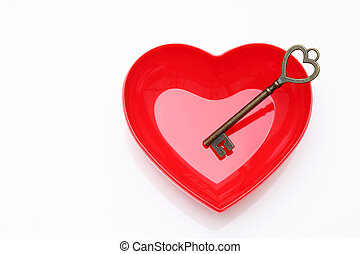 vintage key and red heart on white background