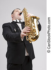 Music Themes and Ideas One Caucasian Male Saxophonist...