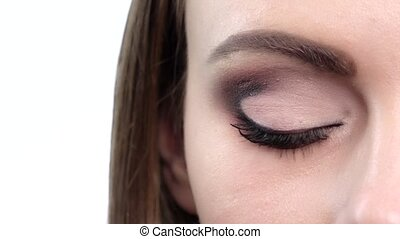 Woman eye with bright makeup Close up Slow motion - Woman...