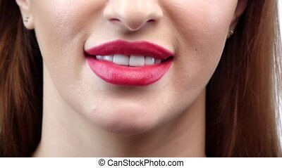 Woman smile. Teeth whitening. Dental care. Close up. Slow...