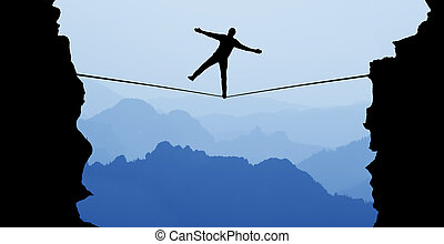 Man balancing on the rope risk taking and challenge concept...