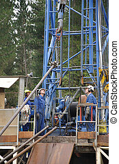 lift that pipe - Drilling crewman prepare to lift a pipe...