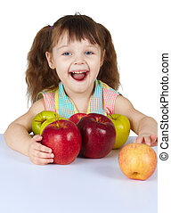 Happy laughing girl with apples