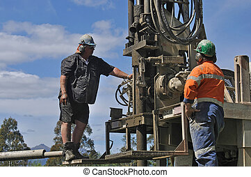 Drilling for water - Crew working a drilling rig in the...