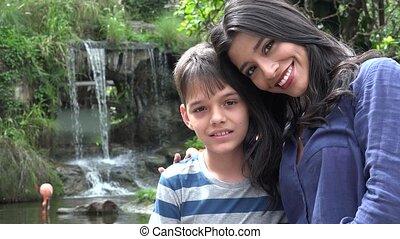 Single Hispanic Mother And Teen Boy