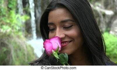 Pretty Hispanic Woman With Pink Flower