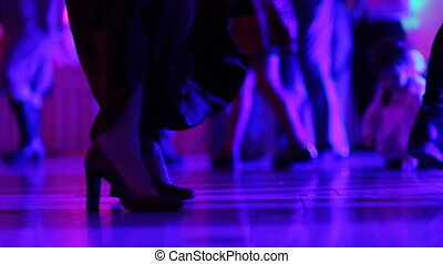 Close up of legs of a woman professional dancer having fun on the night club.