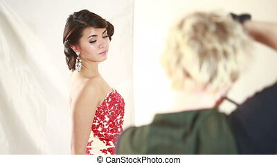 Back view of a man with camera taking a photo. fashion model