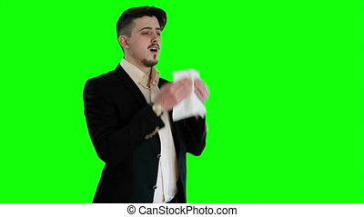 Guy sneezes in napkin - Guy sneezes on a background of a...