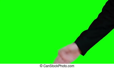 Handshake on the background of a green screen Chroma key