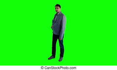 Man eating an apple on a background of a green screen