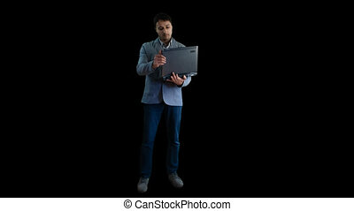 Man in jacket working with laptop alpha channel, chroma key