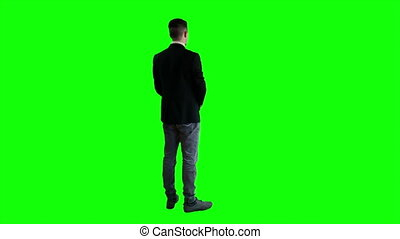 A man in a jacket standing with his back PNG