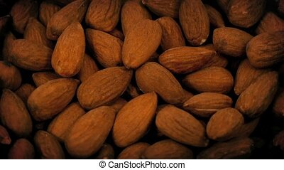 Almond Nuts Rotating Closeup - Closeup of almond nuts...