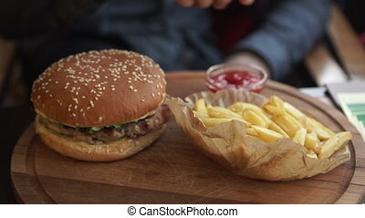 Set of classic american cheese burger and french fries in hands