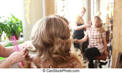 barber makes the cut for adult woman doing curls