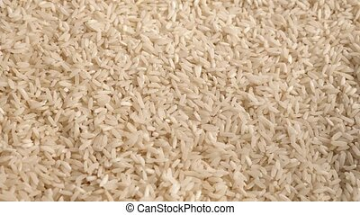 Rice Grains Rotating - Overhead shot of pile of white rice...