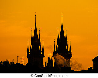 Towers of Tyn church silhouette in morning Prague