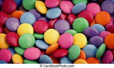Coated Chocolate Candies Rotating - Colorful chocolate...