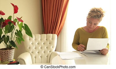 A Stress woman looking at bill - Woman having financial...