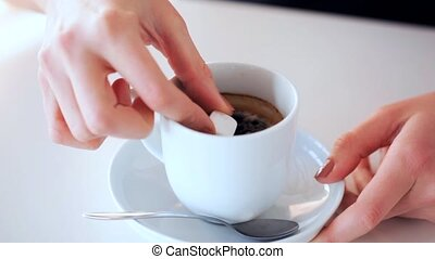 coffee with sugar - woman adding sugar to coffee