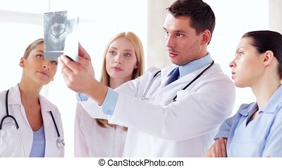 group of doctors with x-ray prints - group of doctors...