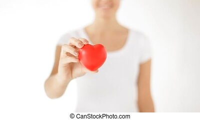 happy woman showing red heart - short clip of happy woman...