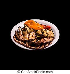 Grilled vegtables on black background still life