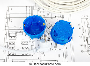 Architecture plan and rolls of blueprints with plug and blue...