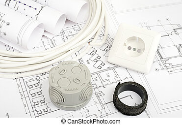 Architecture plan and rolls of blueprints with plug and grey...