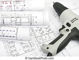 Architecture plan and rolls of blueprints with electric...