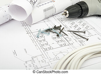 Architecture plan and rolls of blueprints with cabel and...