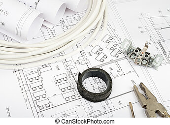 Architecture plan and rolls of blueprints with pliers and...