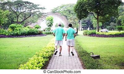 healthy senior couple exercise park - Video of healthy asian...