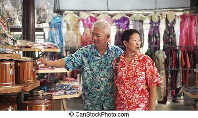 senior tourist shopping in Thailand - Asian senior tourist...