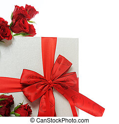 Gift with red roses