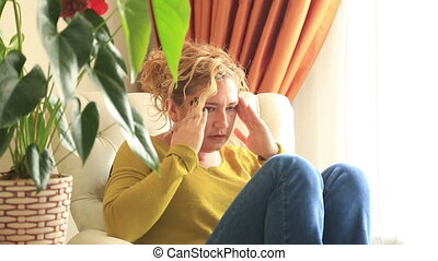 Painful womanwith headache - Painful woman in a couch with...